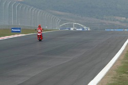 Michael Schumacher inspects the track
