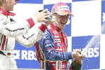 Podium: champagne for Heikki Kovalainen and Nico Rosberg