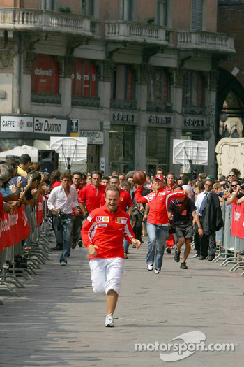 Vodafone race event in Milan: Rubens Barrichello beats Michael Schumacher at running race