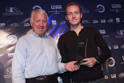 Charlie Whiting presents the award for Most Improved Driver During the Season to Olivier Pla