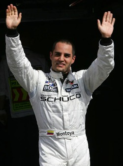 Pole winner Juan Pablo Montoya celebrates