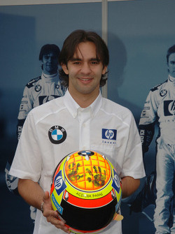 Antonio Pizzonia shows the new helmet design by his nine month old daughter Sophia