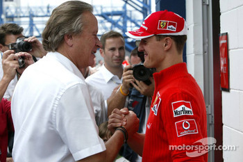 Mansour Ojjeh and Michael Schumacher discuss