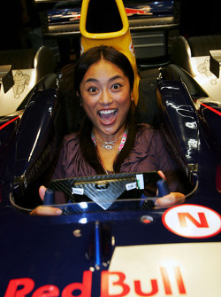 A Formula Unas girl tries the Red Bull car