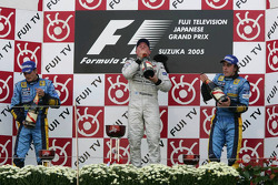 Podium: champagne for Kimi Raikkonen, Giancarlo Fisichella and Fernando Alonso