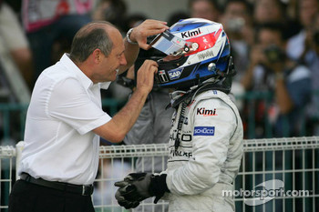 Race winner Kimi Raikkonen celebrates with Ron Dennis