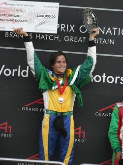 Nelson A. Piquet on the podium