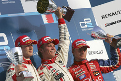 Podium: race winner and 2005 GP2 Series champion Nico Rosberg celebrates with Alex Premat and Heikki Kovalainen