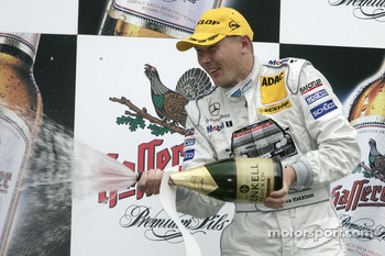 Podium: champagne for Mika Hakkinen