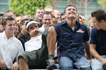 Vitantonio Liuzzi, David Coulthard and Christian Klien pose with Red Bull Racing team members