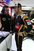 Romain Grosjean, Lotus F1 Team and Julien Simon-Chautemps, Romain Grosjean race engineer, Lotus F1 Team