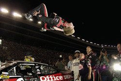 Race winner Carl Edwards celebrates by performing his traditional backflip