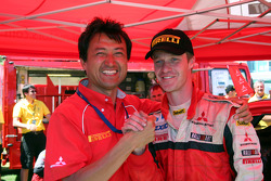 Isao Torii and Harri Rovanpera celebrate podium finish
