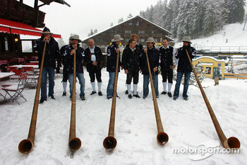 All the drivers and Dr Mario Theissen (BMW Motorsport Director) blow Alpine horns in the snow