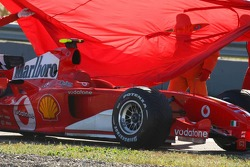Covers are put on the Ferrari of Marc Gene
