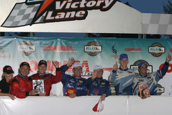 DP podium: race winners Max Angelelli and Wayne Taylor, with Bob Stallings and Alex Gurney, and Jorg Bergmeister and Christian Fittipaldi