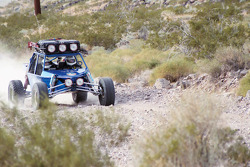 Vanguard Racing: Ronn Bailey crosses the rocky desert terrain in the pre-run practice buggy