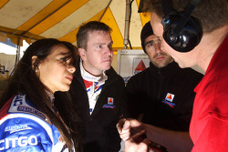 Milka Duno, Kevin McGarrity and Dario Franchitti speak with a crew member