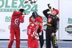 Champagne for the overall winners: Dan Wheldon, Scott Dixon, Casey Mears