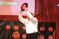 Ken Schrader picks the pole winning beer bottle cap