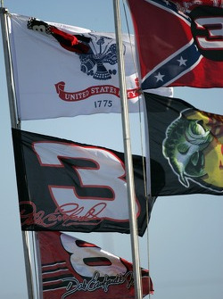 Flags shine in the sun before the start of the practice session