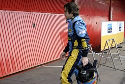 Fernando Alonso back to the pits after stopping on the track