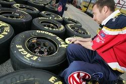 AAA Ford crew member prepares tires