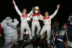 Race winners Allan McNish, Tom Kristensen and Rinaldo Capello celebrate
