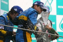 Podium: champagne for Giancarlo Fisichella, Fernando Alonso and Jenson Button
