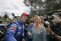 Winner Sébastien Loeb celebrates with wife Séverine