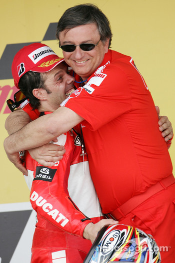 Podium: race winner Loris Capirossi celebrates with Federico Minoli