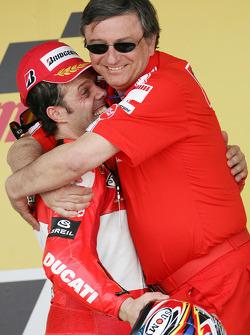 Podium: race winner Loris Capirossi celebrates with Federico Minoli