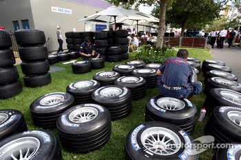Red Bull Racing team members prepare tires