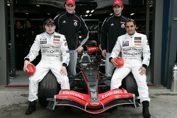 Kimi Raikkonen and Juan Pablo Montoya pose with football players Nathan Buckley and Alan Dodak