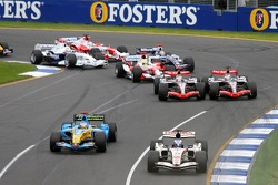 First corner: Jenson Button leads Fernando Alonso while Juan Pablo Montoya and Kimi Raikkonen battle
