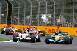 Jenson Button and Fernando Alonso battle