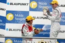 Podium: champagne for Bernd Schneider and Tom Kristensen