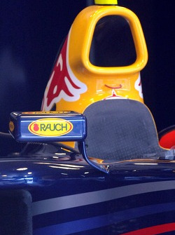 The rearview mirror of a Red Bull Racing car