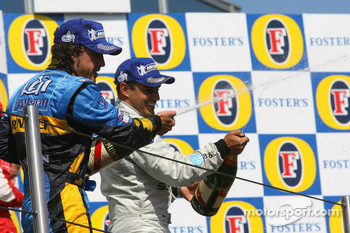 Podium: champagne for Fernando Alonso and Juan Pablo Montoya