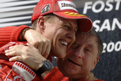 Podium: race winner Michael Schumacher with Jean Todt
