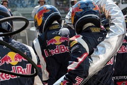The Red Bull Racing pitcrew with the fuel nozzle