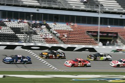 Kurt Busch leads Martin Truex Jr. and Ken Schrader
