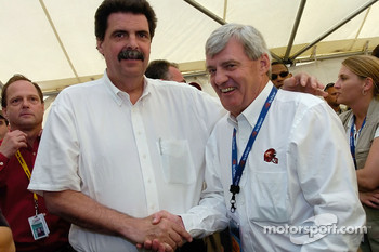 President of NASCAR Mike Helton greets race grand marshall Frank Beanmer
