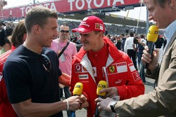 Lukas Podolski and Michael Schumacher
