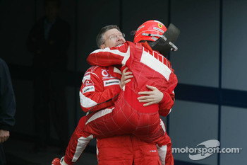 Race winner Michael Schumacher celebrates with Ross Brawn