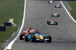 Fernando Alonso leads the field