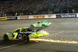 Robby Gordon leaves a trail of sparks from dragging parts