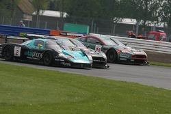 #2 Vitaphone Racing Team Maserati MC 12 GT1: Jamie Davies, Thomas Biagi passes #5 Phoenix Racing Aston Martin DBR9: Jean-Denis Deletraz, Andrea Piccini
