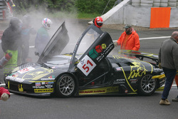 #51 B-Racing RS Line Team Lamborghini Murcielago GTR: Benjamin Leuenberger, Norbert Walchhofer, Marino Franchitti goes up in smoke while waiting for debris to be cleared from crash on first lap