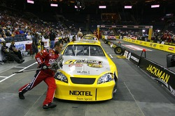 Tracy Duncan, jackman for the Office Depot Team competes, during the NASCAR Nextel Pit Crew Challenge